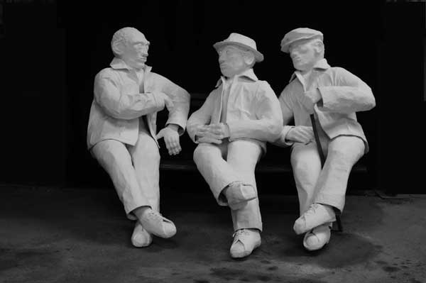 Three men created out of papier mache