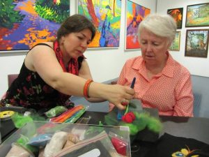 Sevtlana Clarke showing Cathy Couzner dry felting