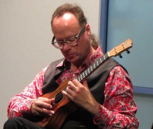 Matthew Fagan playing a stringed instrument