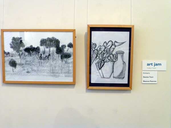 Two drawings one of bush scene with kangaroos , the other a bottle and a pot plant