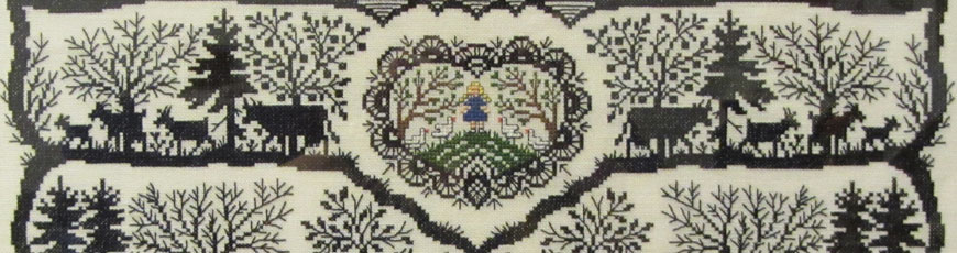 Cross stitch on linen sampler